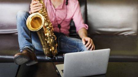 Jazzman holding Saxophone