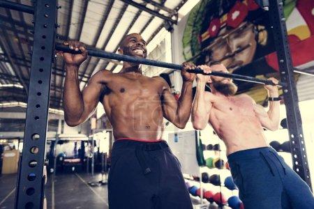 Men exercising in gym