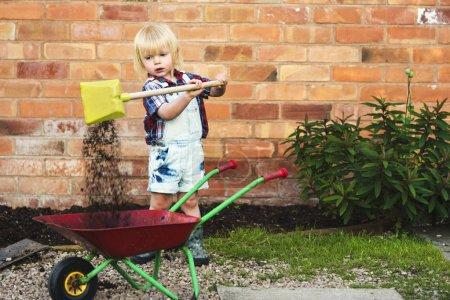 cute kid with garden pushcart