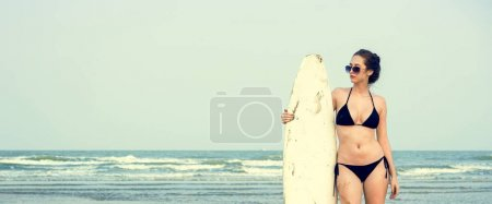 Woman with surf on the beach