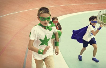 Kids in costumes superheroes