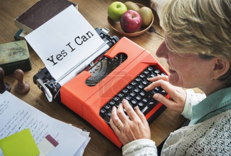 woman typing on vintage typewriter machine
