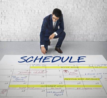 Businessman sitting on floor