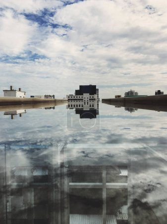 reflection of the Building in the puddle