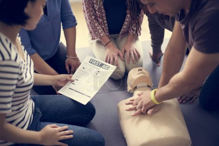 People learning CPR First Aid Training