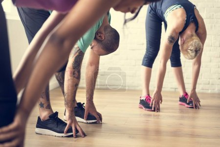 Sportive people doing yoga stretching