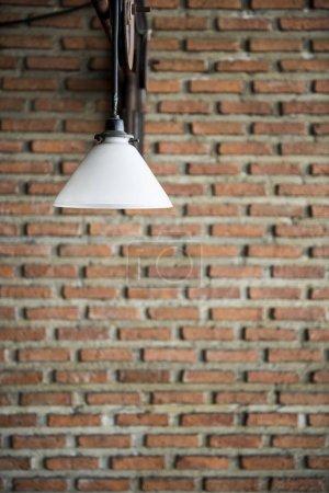 Electric Lamp at Brick Wall