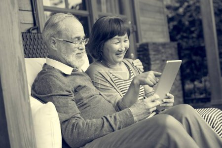Senior People using tablet at home