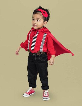 Little asian boy in superhero costume