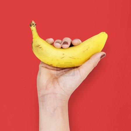 Foto de Mano tiene plátano, original photoset - Imagen libre de derechos