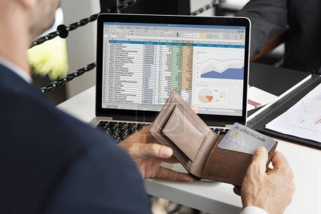 businessman holding wallet with credit card