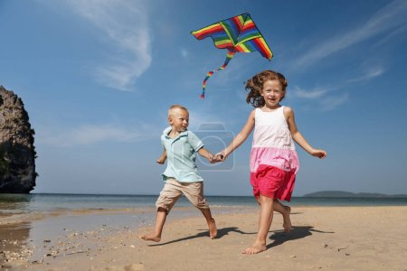 Couple flying a kite