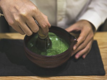 person preparing Japanese Matcha