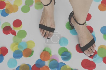 woman Feet in shoes on Confetti