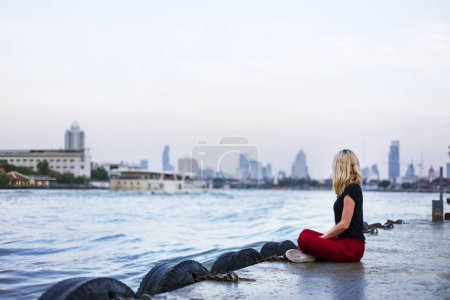 Woman Relaxing near River