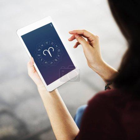 Woman browsing in digital tablet
