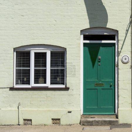 brick house with door and window