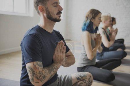 people doing yoga meditation