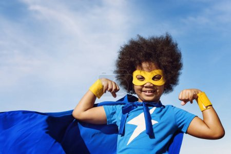 African kid in superhero costume