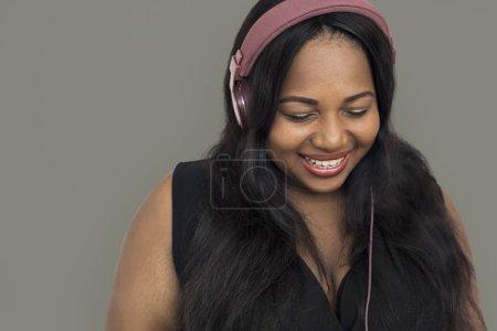 african Woman listening music in headphones