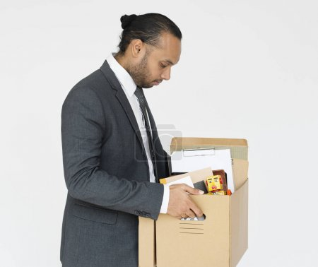 Business man carrying office supplies