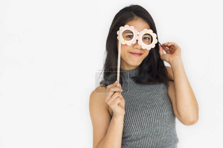 Woman wearing paper glasses