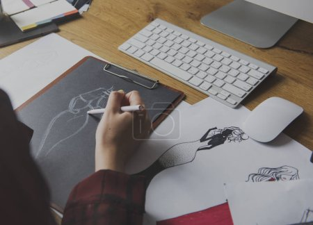 Fashion Designer sketching