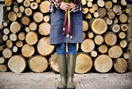Woman standing in rubber boots
