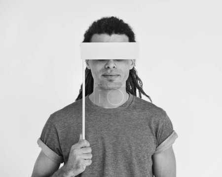 man Covering Eyes with blank