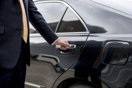 Businessman Holding car handle