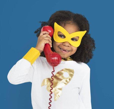 girl in mask holding telephone
