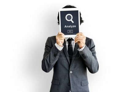 Photo for Business person holding tablet before the face, Strategy Concept - Royalty Free Image