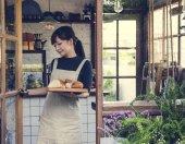 Waitress working in shop