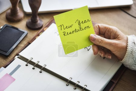 Person holding paper note