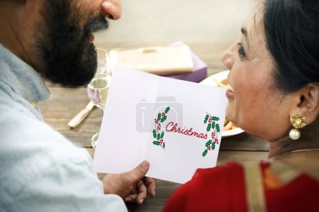 couple holding card