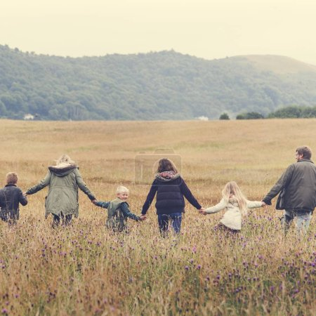 Happy Family together in field