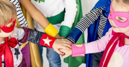 Kids in costumes super heroes