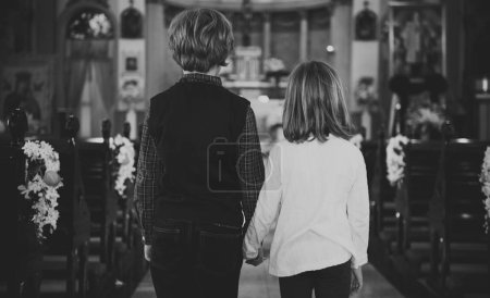 Children praying in Church