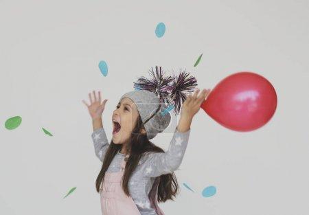 Little Girl celebrating with balloons