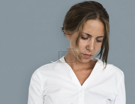 Pensive young businesswoman