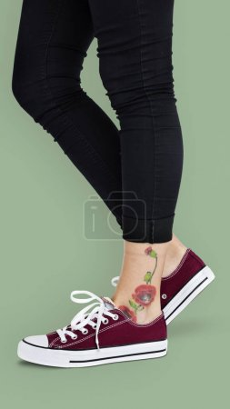 woman in Shoes with tattoo on leg