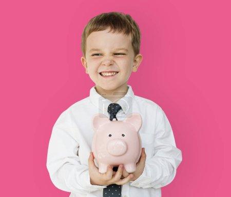 boy holding piggy bank