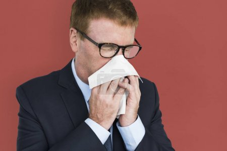 businessman Sneezing in napkin