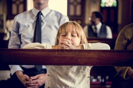 girl praying in church