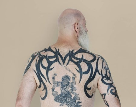 Man with tattoo on back