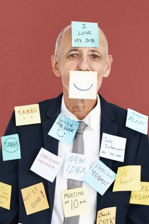 senior business man in sticky notes