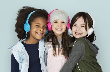 Girls listening music in headphones