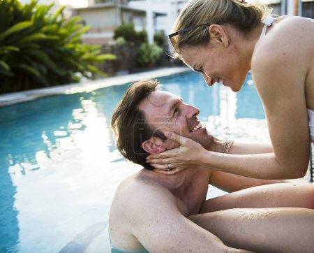Couple hugging near swimming pool