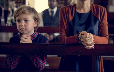 mother and son in church