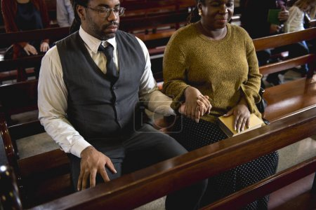 couple holding hands in church